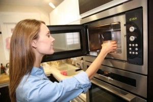 Woman using microwave