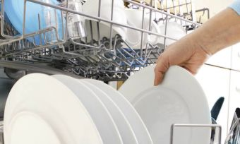 unstacking a dishwasher