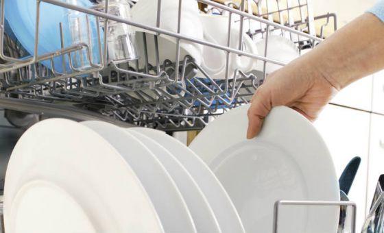 unstacking a dishwasher