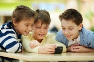 Boys using smartphone