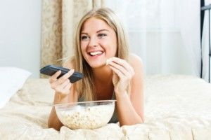 Women watching tv popcorn