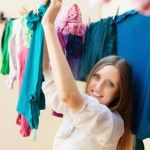 Woman hanging clothesline