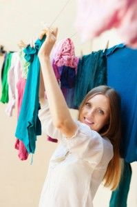 Woman hanging clothesline