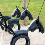 Tyre swing horses