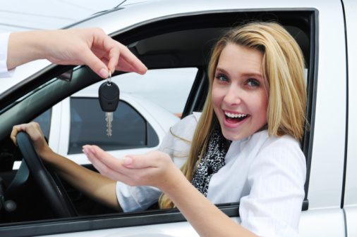 Woman receiving car keys