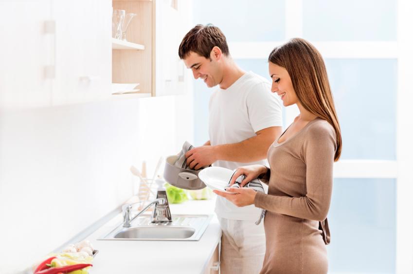 Couple washing dishes.