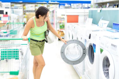 Woman washing machine shopping