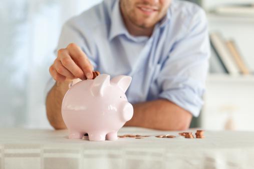 Man piggy bank saving