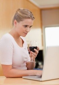 Woman laptop wine