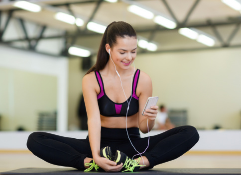 Smiling woman stretching gym mp3