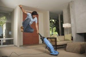 Vacuuming man
