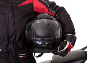 Man holding helmet under arm