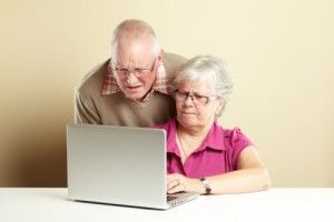 Senior couple laptop confused
