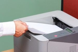 Businessman working with printer