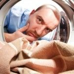 Man laundry fabric thinking