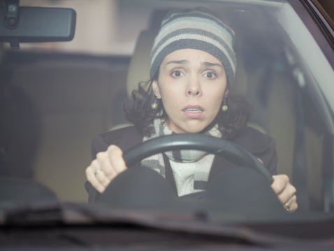 Nervous woman driving