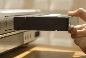 inserting vhs cassette