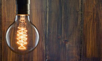 Light bulb with wooden background