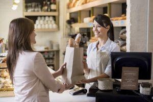 Woman helping customer at the bakery