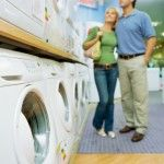 Couple washing machine shopping