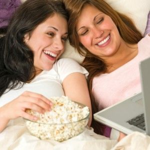 Women laptop popcorn