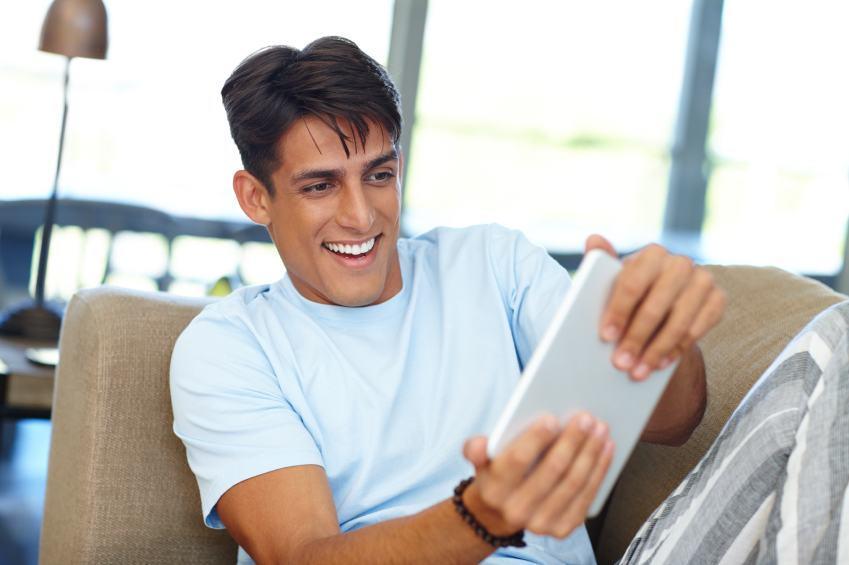 Man playing tablet game