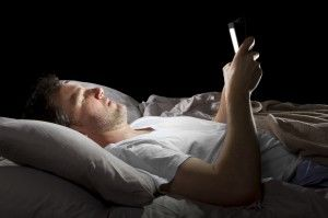 man in bed look at tablet