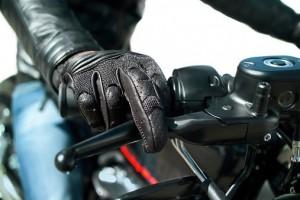 motorcycle glove holding handlebar